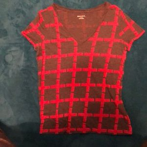 A grey v neck top with a really cool red pattern